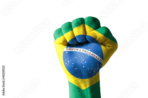 Fist painted in colors of brazil flag