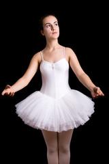 Ballerina posing against black background