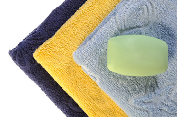 towels and soap on a white background