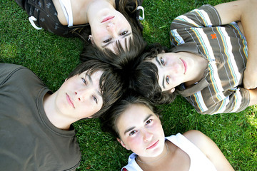 Teenagers lying in the grass
