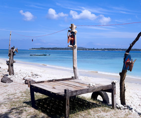 Wooden beach lounger on the beach