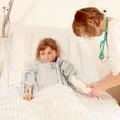 Krankenschwester legt Verband an
