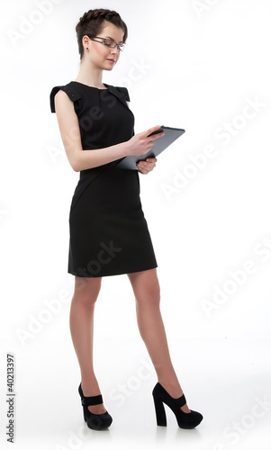 Beautiful  businesswoman in glasses holding a laptop