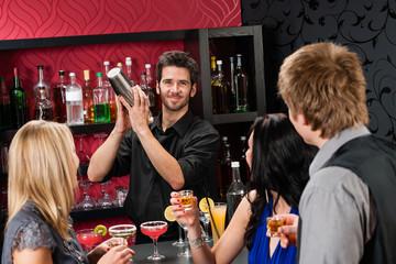 Barman cocktail shaker friends drinking at bar