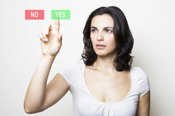 woman using new technologies pushing Yes button