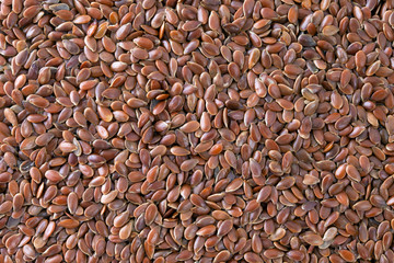 Flax seeds (Linum usitatissimum) texture background.