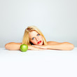 beautiful young blond girl with green apple