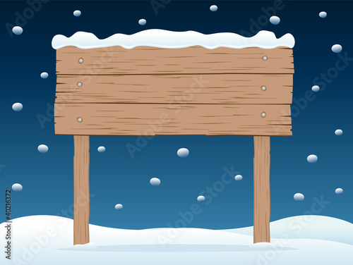 wooden signboard in snowy night