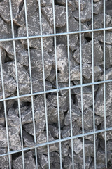gray rocks in a cage