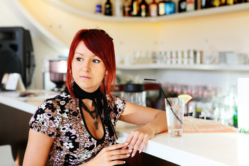 young pretty girl sitting at the bar counter