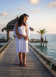 Sensual happy couple in white clothes on a pier (Maldives)