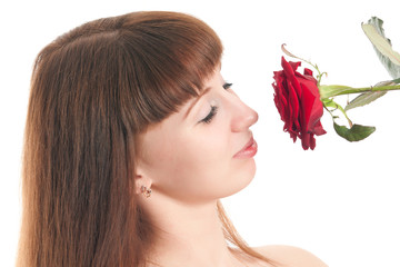 The girl with a rose on a white background