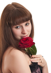 The beautiful girl with a red rose on a white background