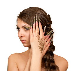 Beautiful model girl makeup with braid and nails iguanas