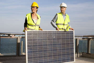 construction workers with solar panel
