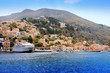 boats and houses on symi island, Greece..