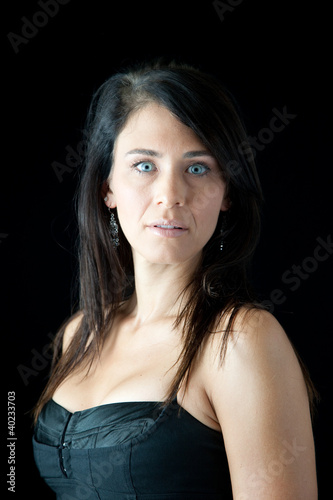 Pretty woman in black blouse looking thoughtfully at the camera