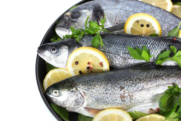 Fresh fishes with lemon, parsley and pepper
