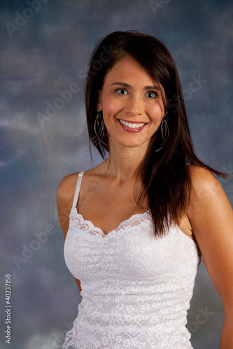 Pretty smiling woman in white top looking at camera