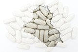 Outline map of iraq with pills in the background for health and