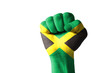 Fist painted in colors of jamaica flag