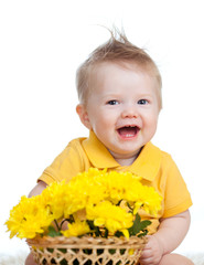 laughing baby boy with flowers in basket