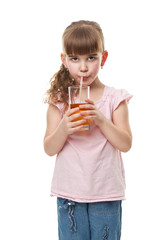 Portrait of happy  girl drinking  juice. Isolated on white.
