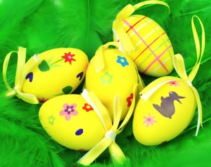Easter eggs on green feathers
