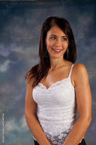 Pretty dark haired woman smiling at camera