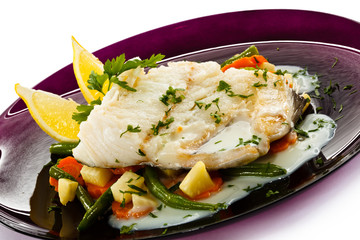 Fish dish - fish fillet in sauce and vegetables