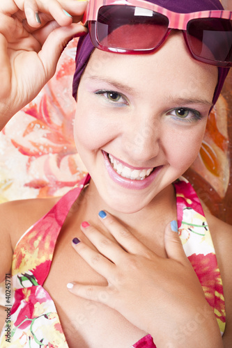 smiling beautiful girl with colored nails