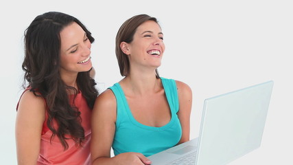 Two girls using a laptop