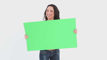 Woman shaking green card