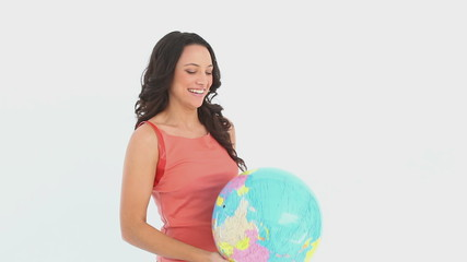 Girls plays with a globe