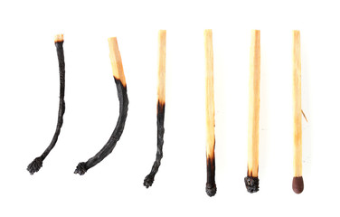burnt matches and one whole match isolated on white