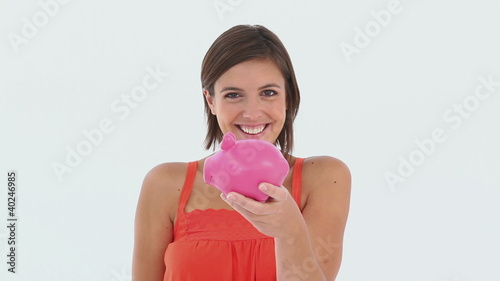 Girl makes a deposit in her piggy bank