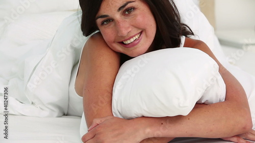 Brunette haired woman lying on her front