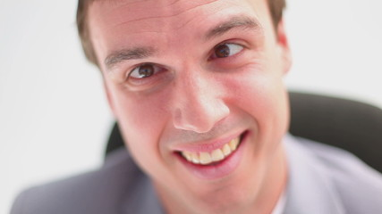 Close-up of a happy man grinning