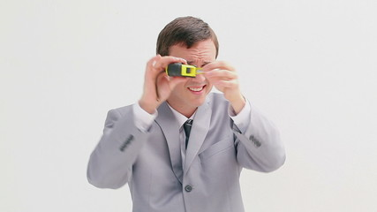 Businessman holding a measuring tape