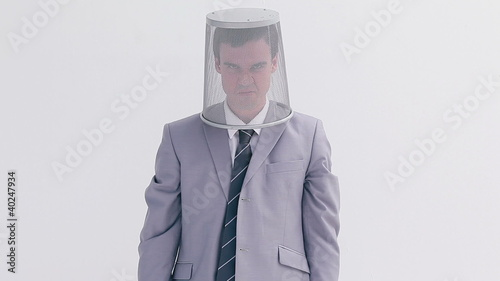Angry man placing a bin on his head