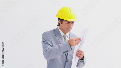 Architect wearing a yellow helmet