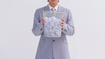 Serious businessman holding a bin