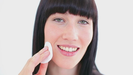 Happy woman using a cotton wool
