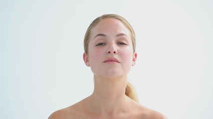 Peaceful woman massaging her neck
