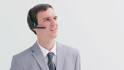 Happy businessman using a headset