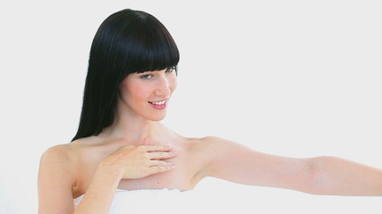 Smiling woman massaging her arm