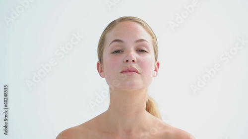 Peaceful woman massaging her neck