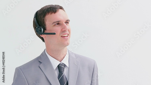 Happy businessman using a headset