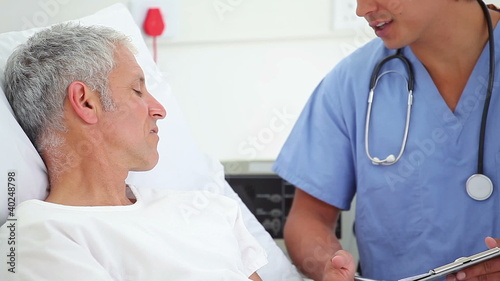Serious patient talking with his doctor