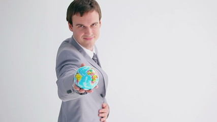Businessman showing a small globe